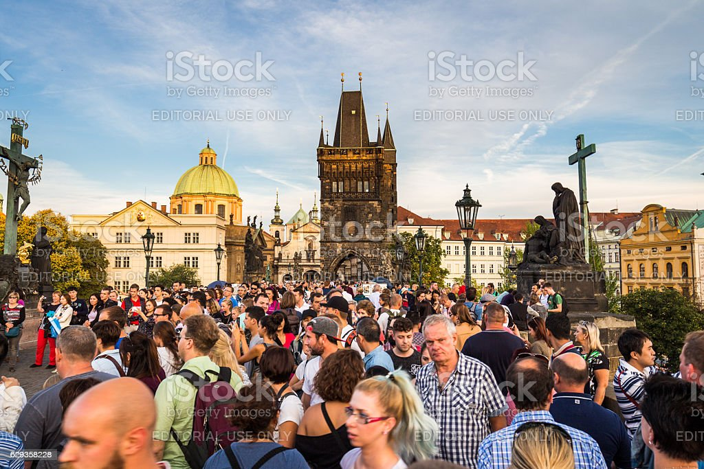 People are walking over the famous Charles bridge in Prague stock photo