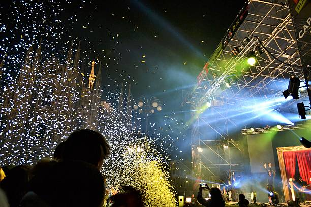 People are watching New Year's concert at Milan Duomo square. stock photo