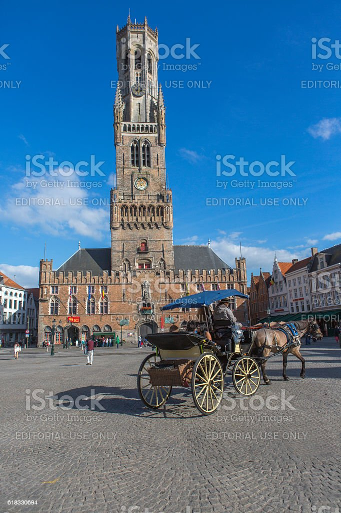 People  around historical gothic buildings at market-place in brugge belgium stock photo