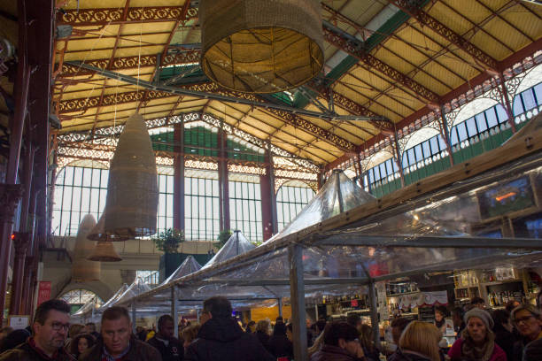 People around the famous Mercato centrale in Florence, Italy FLORENCE, ITALY - NOVEMBER 22 2015: People around the famous Mercato centrale in Florence, Italy mercato stock pictures, royalty-free photos & images