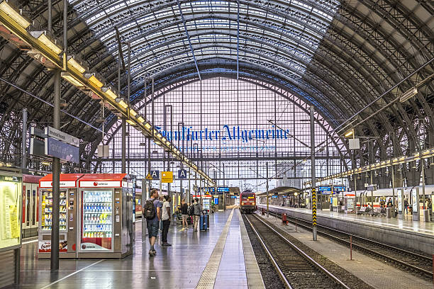 people arrive and depart at Frankfurt train station Frankfurt, Germany - August 31, 2016: people arrive and depart at Frankfurt train station. The classicistic train station opened in 1899 and is the biggest in Germany. depart stock pictures, royalty-free photos & images
