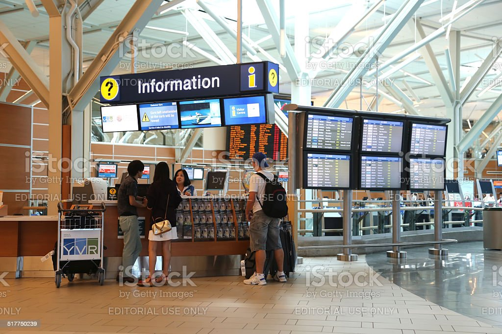People asking some information insdie the YVR airport stock photo