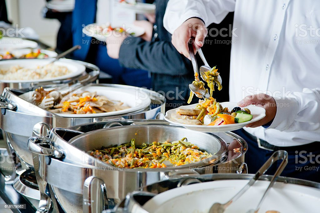 people at a banquet stock photo