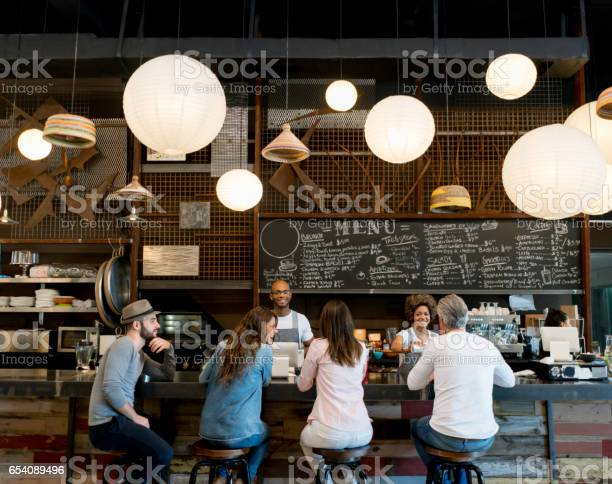 People at a cafe picture id654089496?b=1&k=6&m=654089496&s=612x612&h=h 65siefzikonq8atcqcop1qqqoiuhbf7yfpotcsh8g=