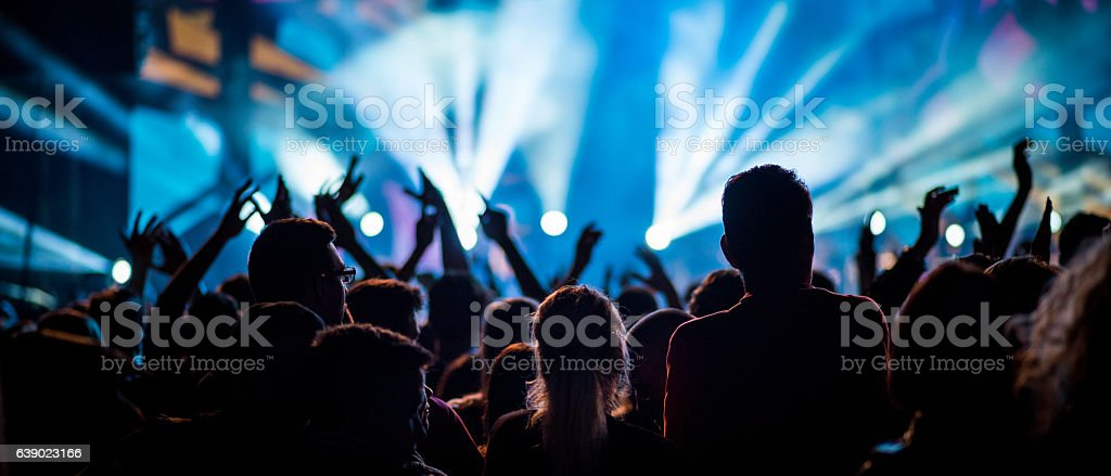 People at a concert with raised hands stock photo