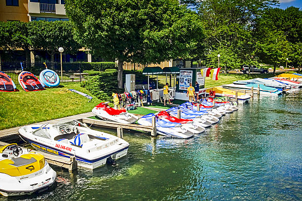 people at a jetskis rental-shop at lake geneva in wisconsin - lake geneva stock photos and pictures