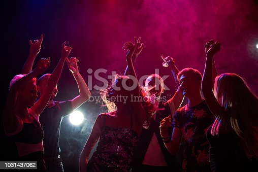 Group of teenagers having fun at nightclub