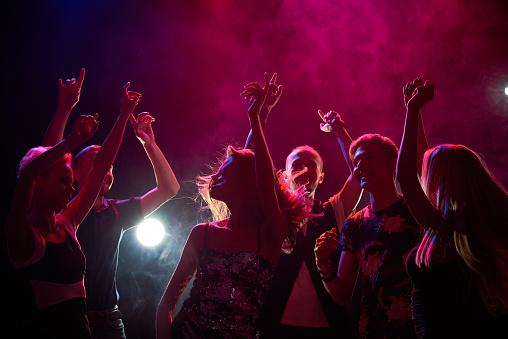 Group of teenagers having fun at nightclub