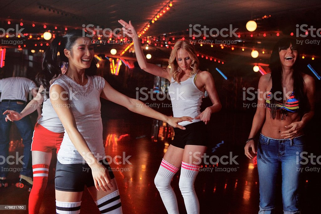 People at a Retro 70's Roller Disco stock photo