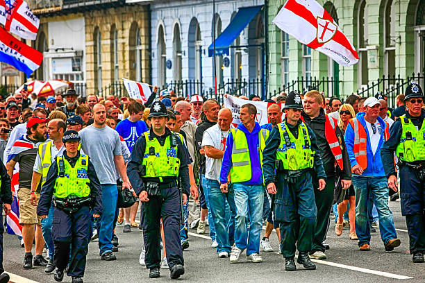 People at a Right-wing EDL demonstration in Weymouth, UK stock photo