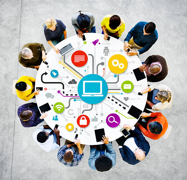 People at a round table with networking graphic. stock photo