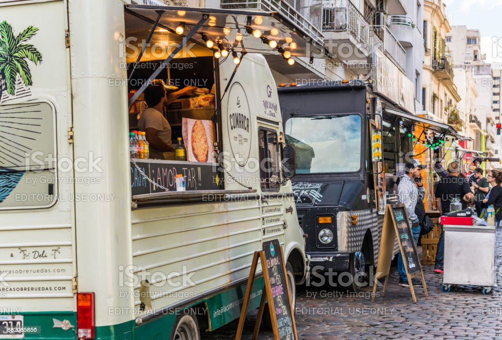People at a street food market festival on a sunny day stock photo