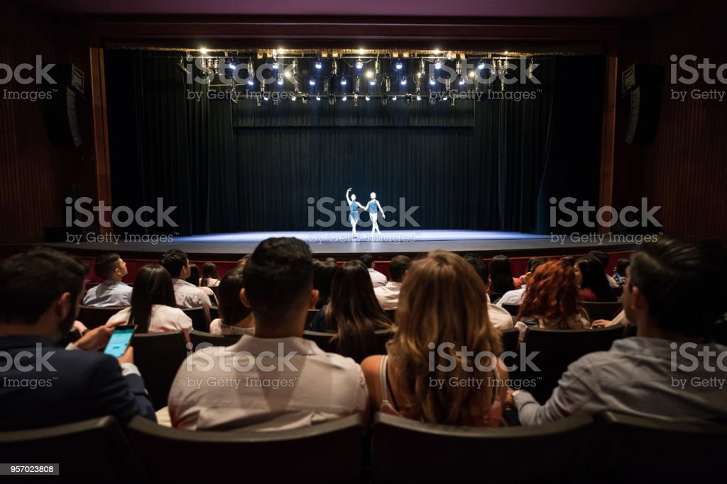 People at a theater looking at a dress rehearsal of ballet performing arts stock photo