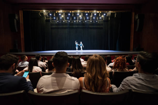 People at a theater looking at a dress rehearsal of ballet performing arts - foto stock