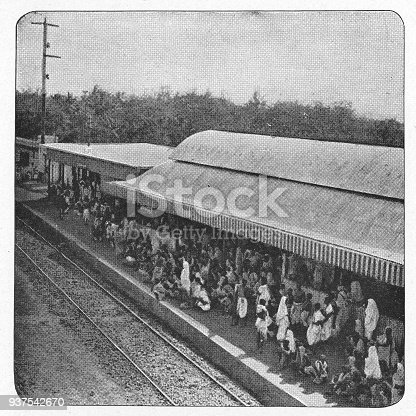 People at a train station in Agra, India during the british era. Vintage halftone circa late 19th century.