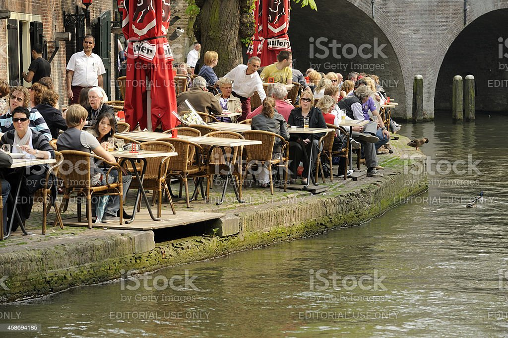 People at an outdoor restaurant on the wharf along Oudegracht royalty-free stock photo
