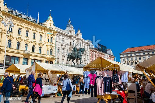 Zagreb, Croatia - April, 2018: People at an street market at Zagreb main square in a beautiful early spring day