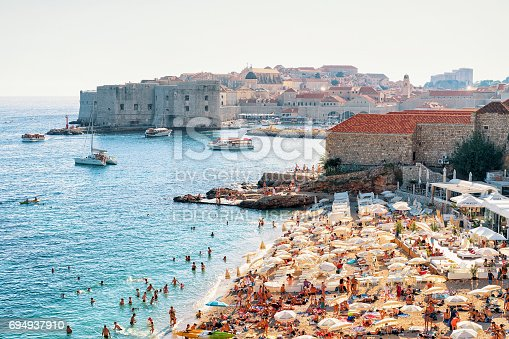 istock People at Banje Beach and Old fortress in Dubrovnik 694937910
