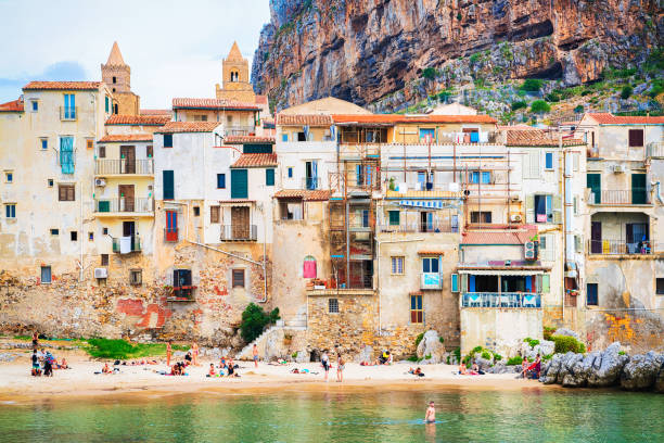 People at beach Cefalu old town Sicily - foto stock