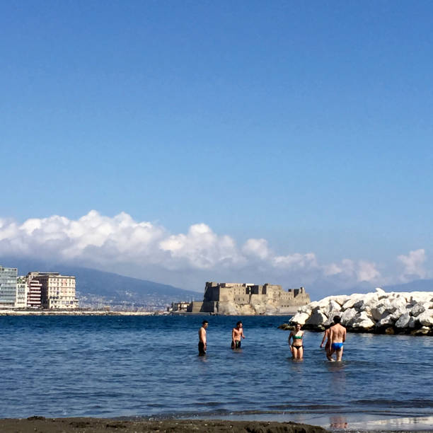 People at beach in Naples, Italy. stock photo