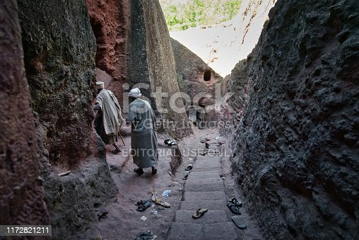 Lalibela, Ethiopia - January 08, 2019: People going through walls of a tunnel at Bete Maryam church during Genna or Ethiopian Christmas, in Lalibela, Ethiopia.