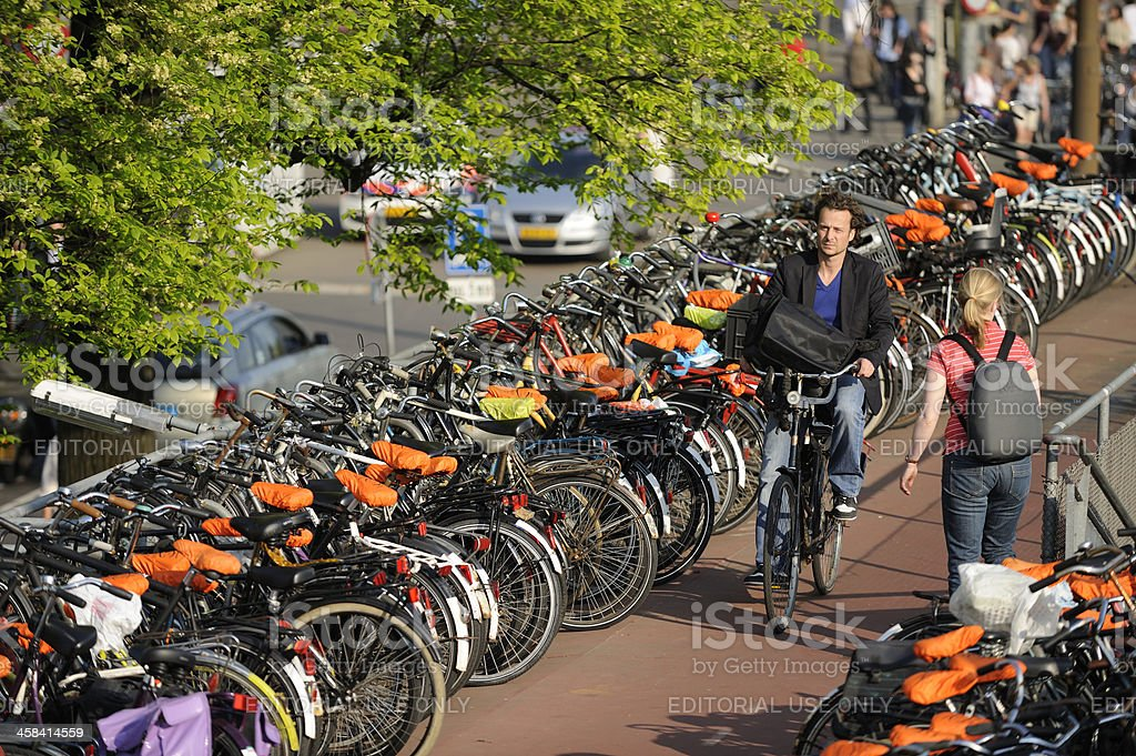 People at bicycle parking next to Amsterdam Central railway station royalty-free stock photo