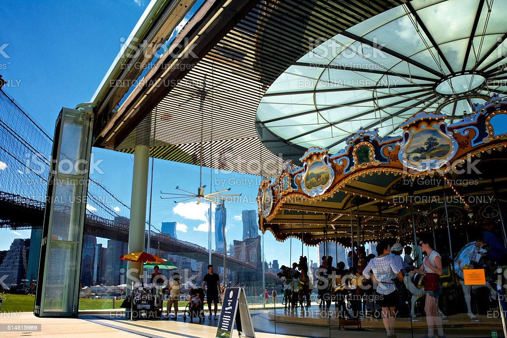 People at Brooklyn Bridge Park Carousel, New York City stock photo