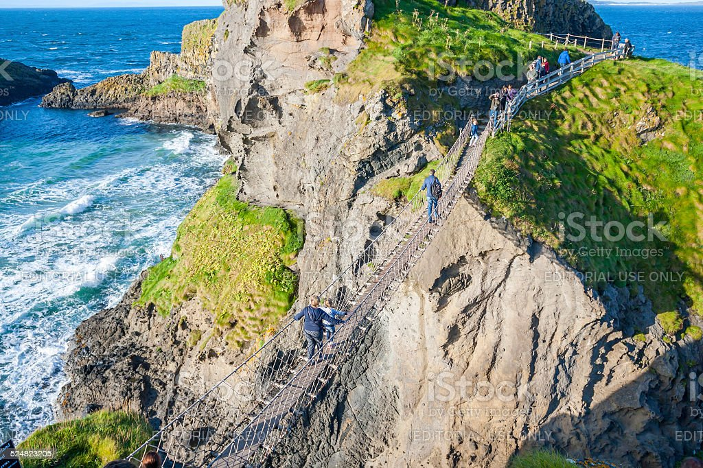 People at Carrick a rede Rope Bridge stock photo
