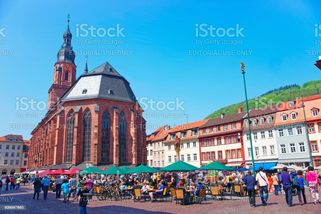 People At Cathedral Of Holy Spirit On Square Heidelberg Stock Photo