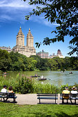New York City, USA - July 29, 2018: People enjoying a summer's day's view at The Lake in Central Park, West Side of Manhattan.