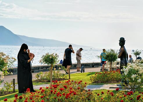People at Charlie Chaplin statue at Geneva Lake Vevey