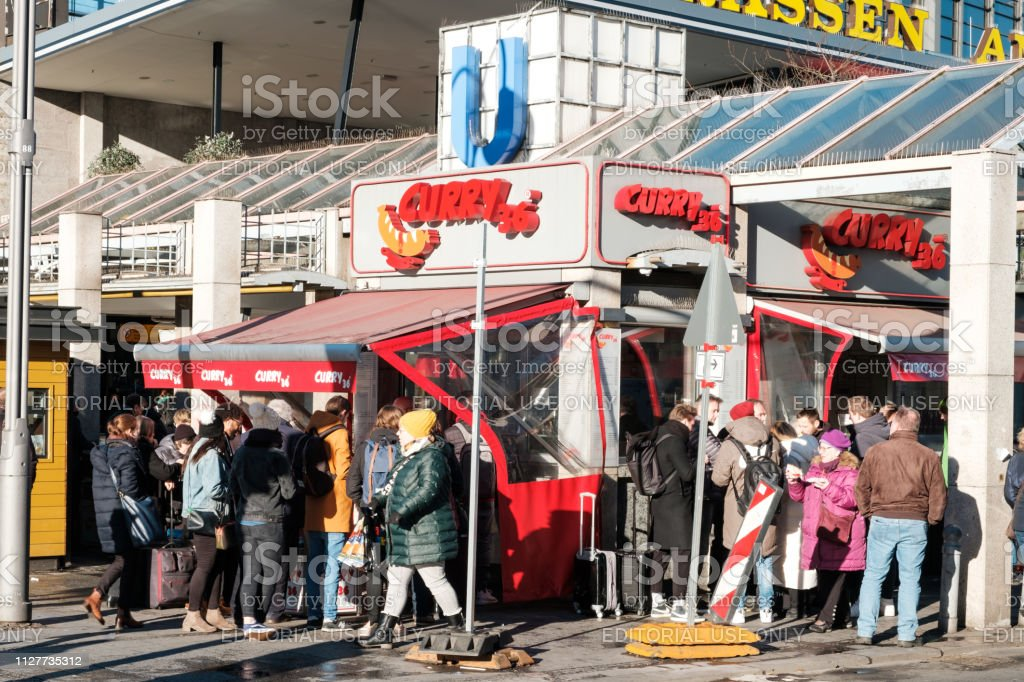 People at   Curry 36, the most famous curry sausage fast food restaurant  in Berlin stock photo