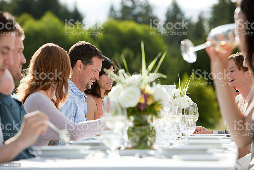 People at dinner party outdoors stock photo