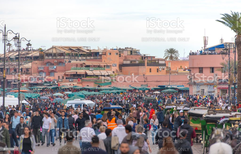 People at Djemaa el Fna square or market in Marrakech in Morocco stock photo