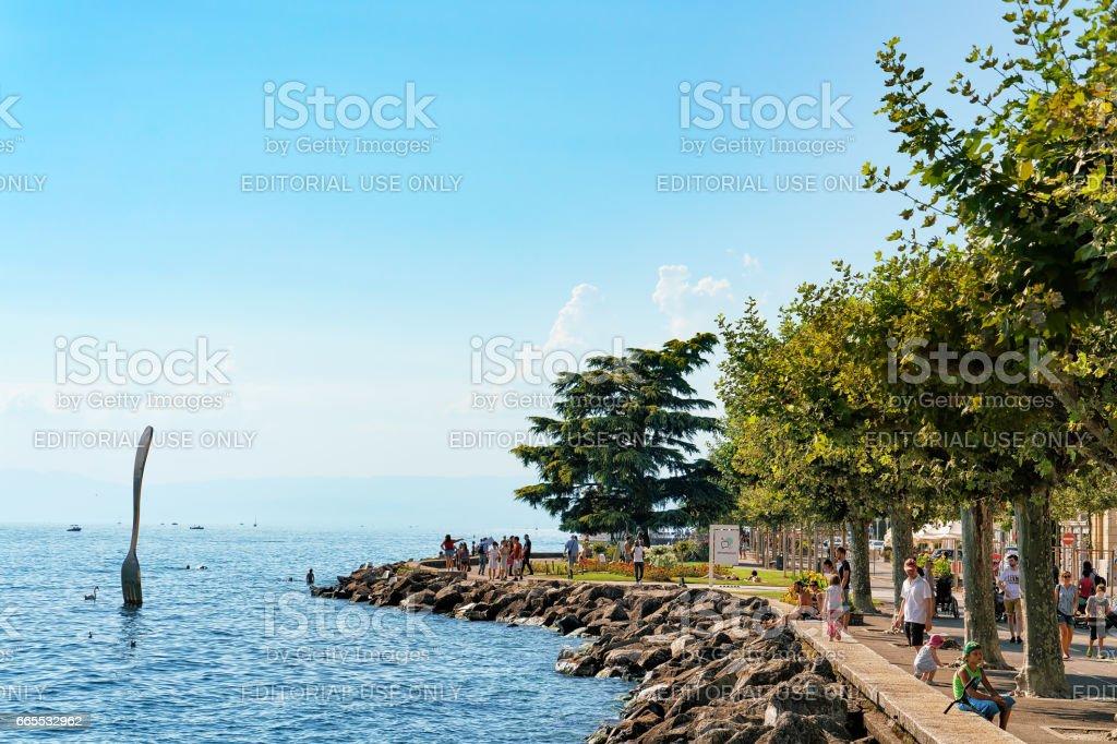 People at embankment of Geneva Lake of Vevey Switzerland stock photo