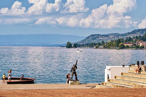People at Freddie Mercury statue at Geneva Lake in Montreux