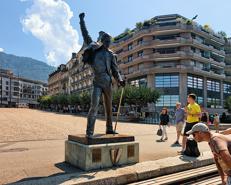 People at Freddie Mercury statue at Geneva Lake Riviera in Montreux