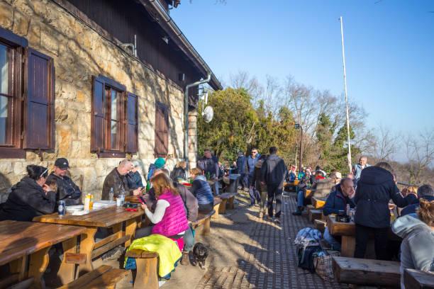 People at Glavica mountain hut stock photo