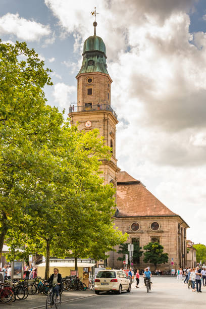 People at Hugenottenkirche church in Erlangen Erlangen: People at the Hugenottenkirche church in Erlangen, Germany on August 20, 2017. erlangen stock pictures, royalty-free photos & images