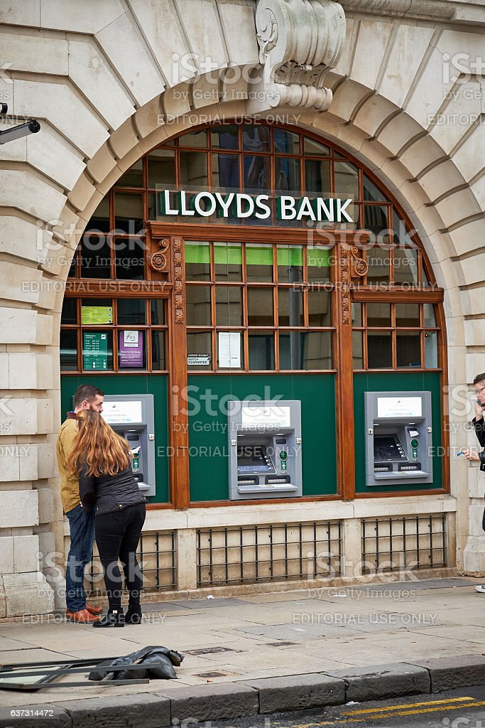 People at Lloyds bank atm, cash dispenser stock photo