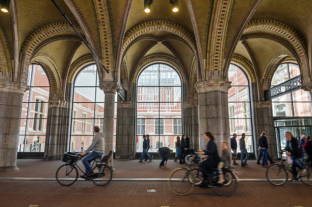 People at main entrance of the Rijksmuseum passage Amsterdam, Netherlands - May 6, 2015: People at main entrance of the Rijksmuseum passage on May 6, 2015. Rijksmuseum is a Netherlands national museum dedicated to arts and history in Amsterdam. rijksmuseum stock pictures, royalty-free photos & images