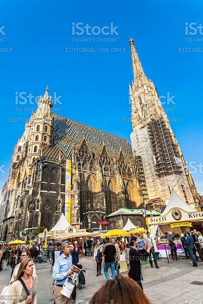 people at market at St. Stephan cathedral in Vienna stock photo