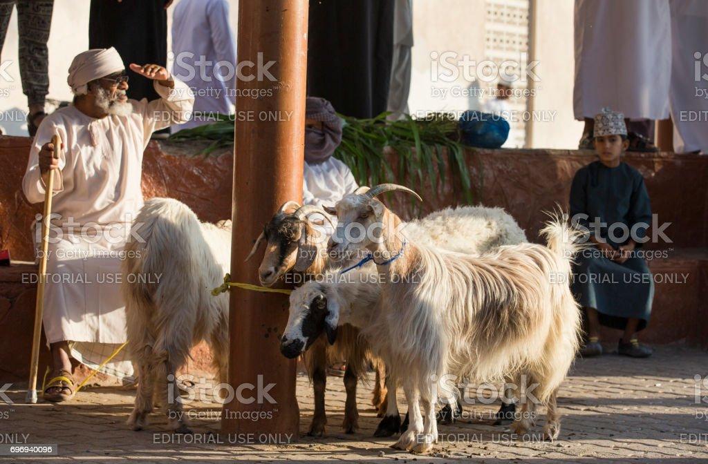 People at Nizwa goat market stock photo