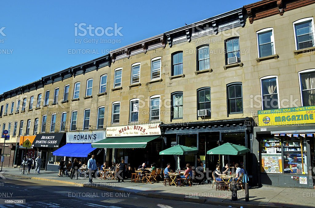 People at outdoor tables of restaurants, Brooklyn, New York City royalty-free stock photo