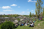Berlin, Germany - april 30, 2017: People at park (Mauerpark) on a sunny day in Berlin, Germany.