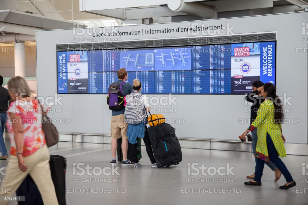 People at Pearson International Airport stock photo