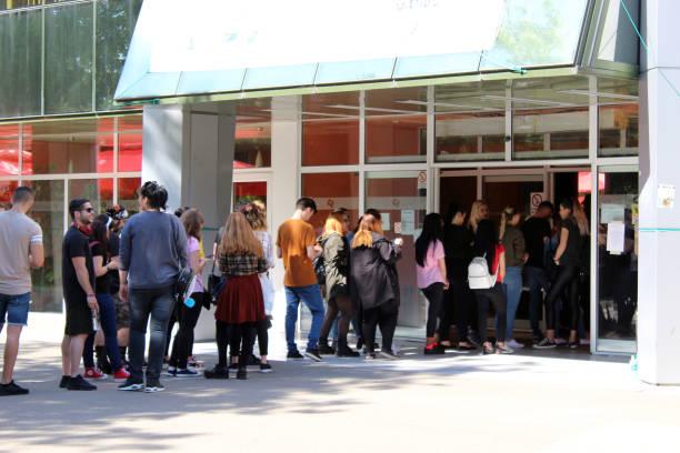 people at queue for vote in european election and national justice referendum - fare la fila foto e immagini stock