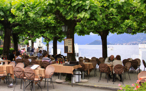People at restaurant in Bellagio, Lake Como, Italy stock photo