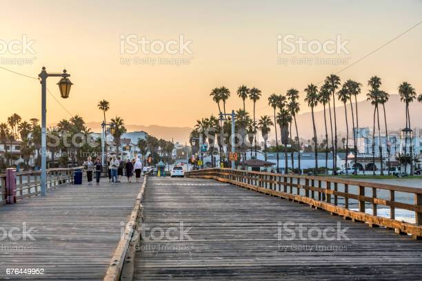 People At Scenic Old Wooden Pier In Santa Barbara In Sunset Stock Photo - Download Image Now