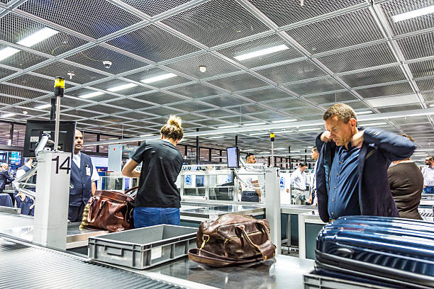 people at security check at Frankfurt international airport stock photo